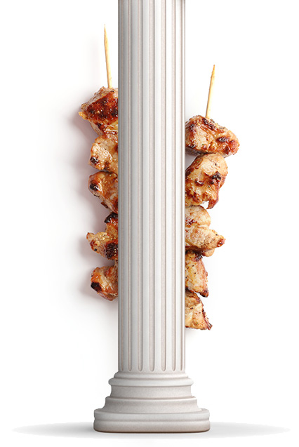 Ancient Pillar With Chicken on Kebab Behind